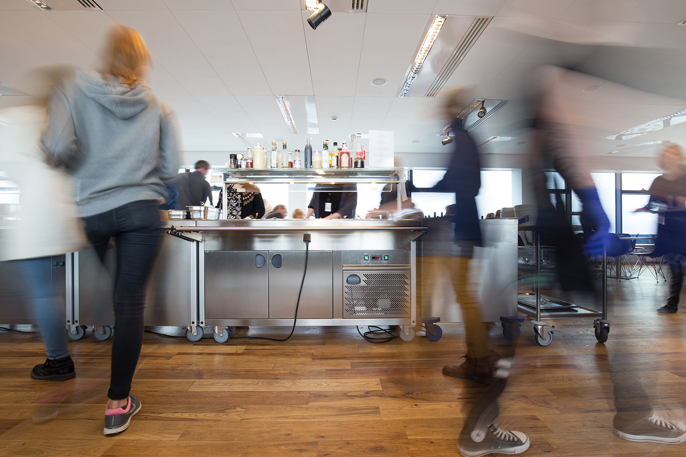 Motion,Blurred,People,At,Lunchtime,In,A,Busy,Canteen